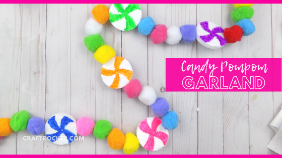 Colorful Candy Garland on Wood Background with text overlay - Candy Pompom Garland - Craft Rocker