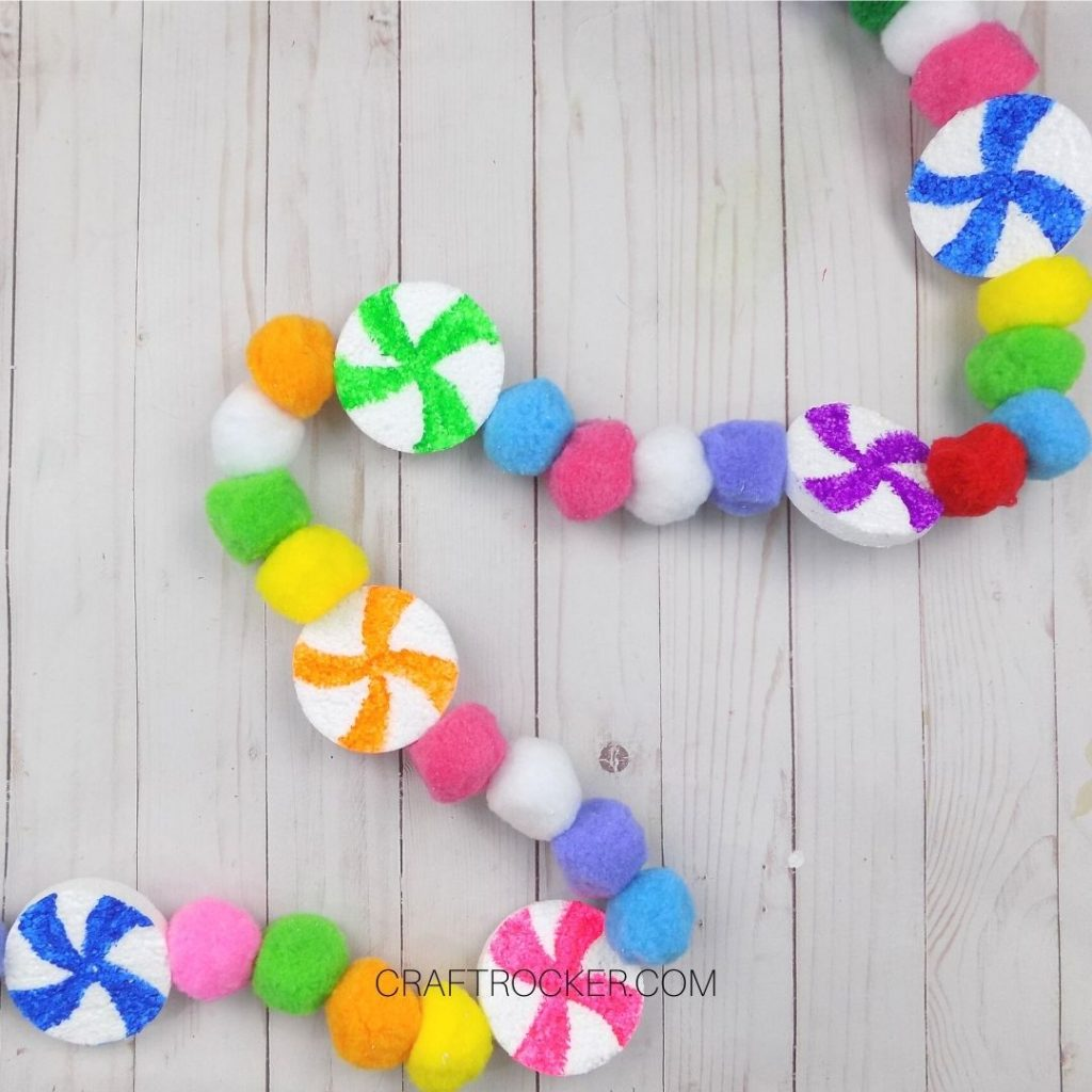 Colorful Candy Pompom Garland on Wood Background - Craft Rocker