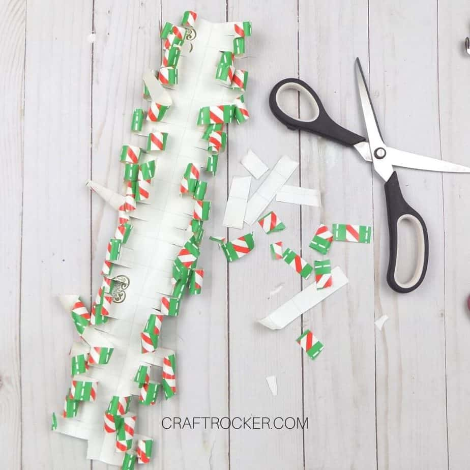 Curled Fringes of Wrapping Paper next to Scissors - Craft Rocker