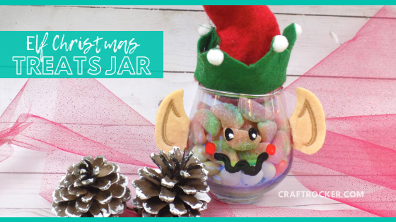 Elf Treat Jar next to Pine Cones with text overlay - Elf Christmas Treats Jar - Craft Rocker