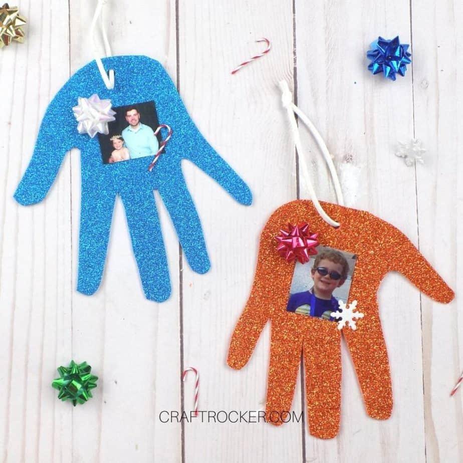 Glitter Handprint Ornaments on Wood Background - Craft Rocker