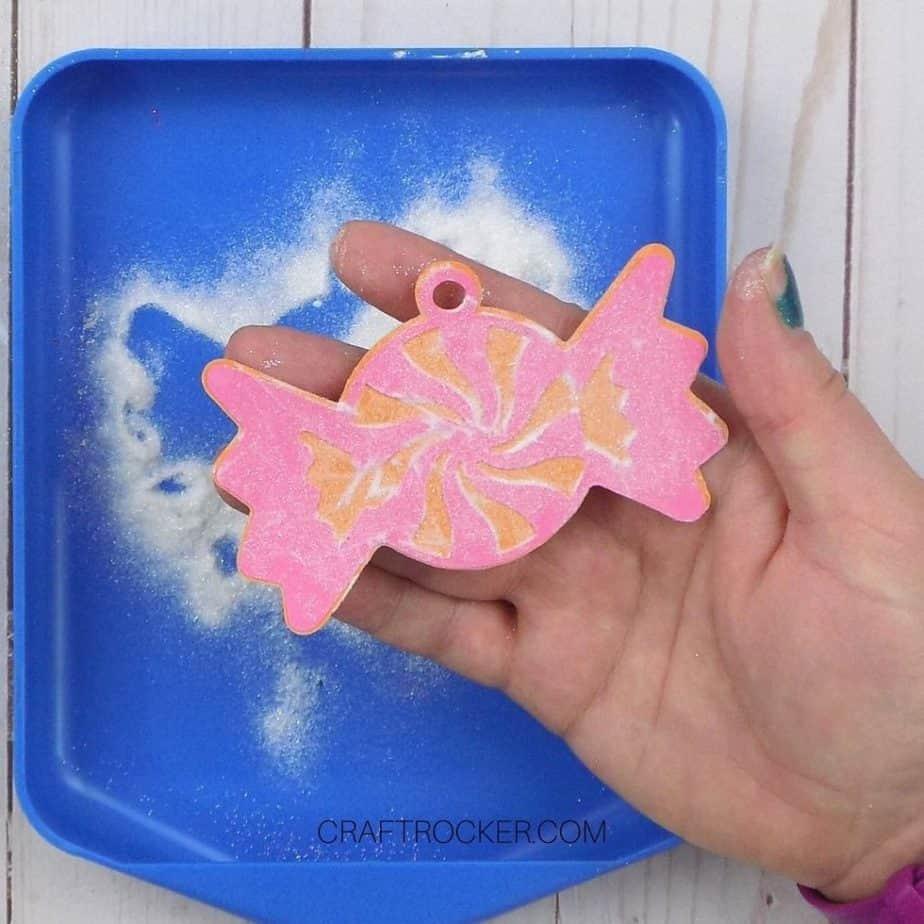 Hand Holding Glitter Paper Candy - Craft Rocker
