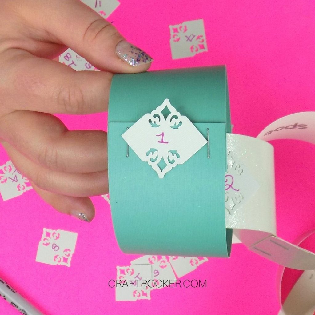 Hand Holding Paper Chain Link with the Number 1 on It - Craft Rocker