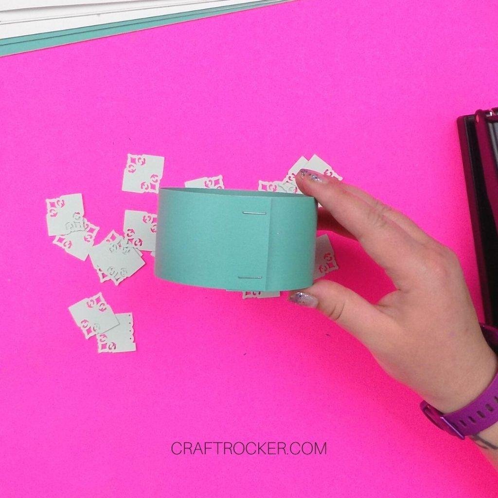Hand Holding Stapled Paper Circle - Craft Rocker