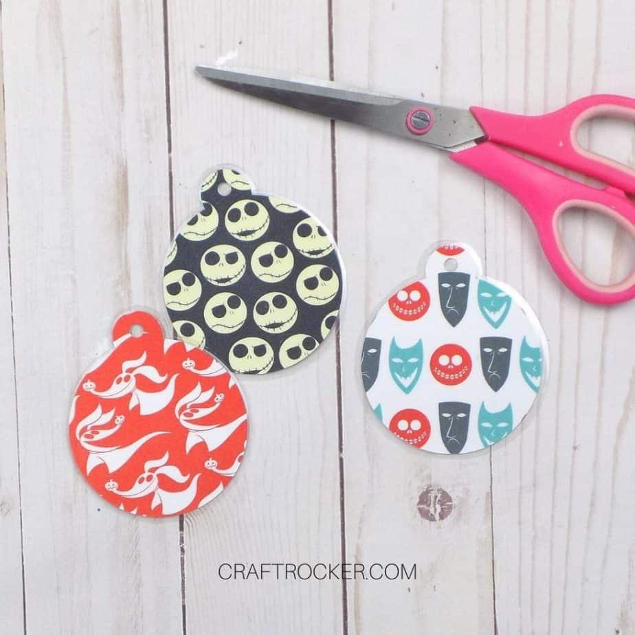 Laminated Ornaments next to Pink Scissors - Craft Rocker