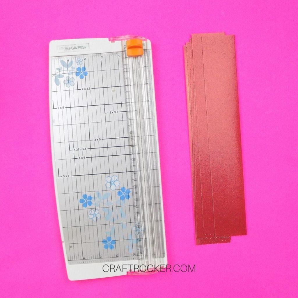 Paper Cutter Next to Strips of Cardstock - Craft Rocker