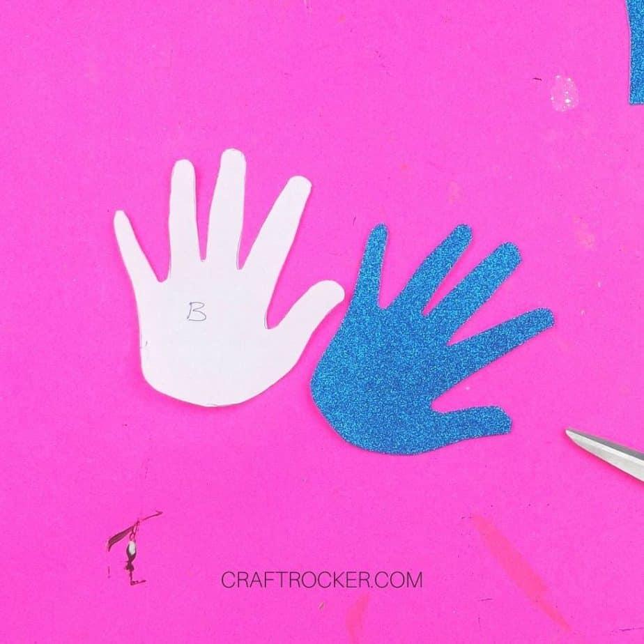 Paper Handprint Cutout next to Glitter Foam Handprint - Craft Rocker