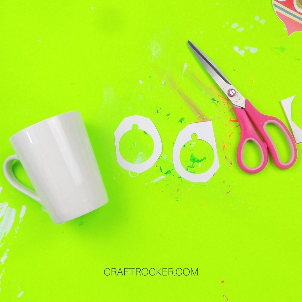 White Mug next to Ornament Outlines and Paper Towel - Craft Rocker