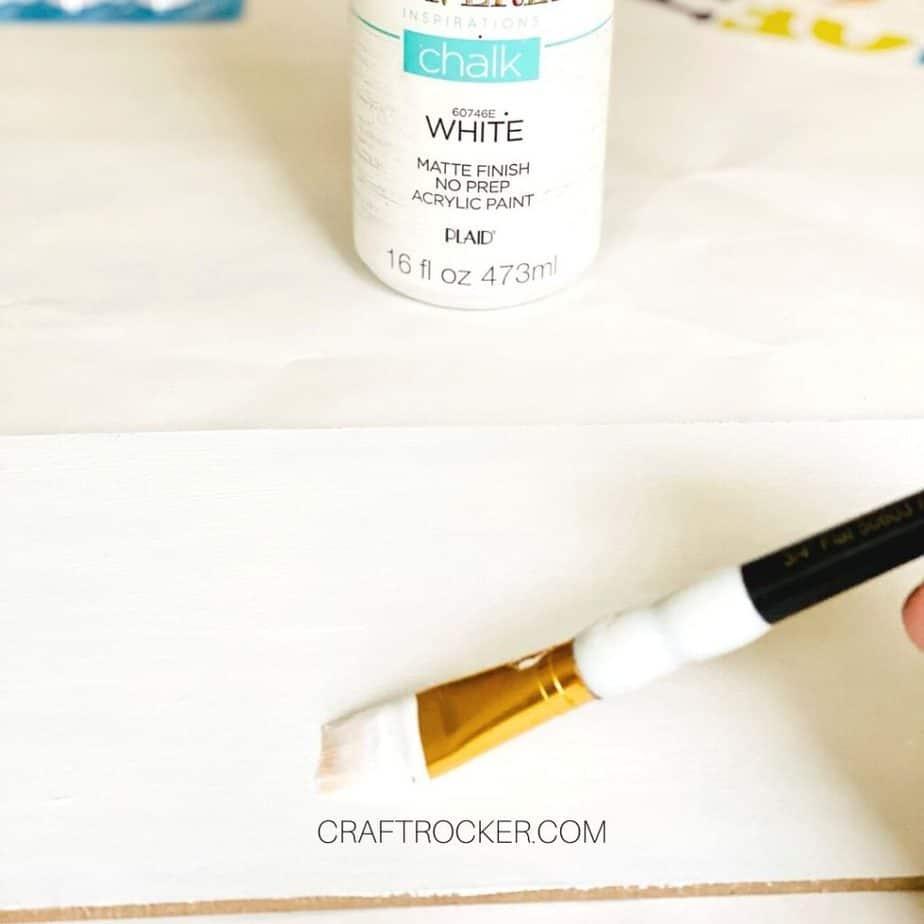 Close Up o Paint Brush Adding White Paint to Wood Sign - Craft Rocker
