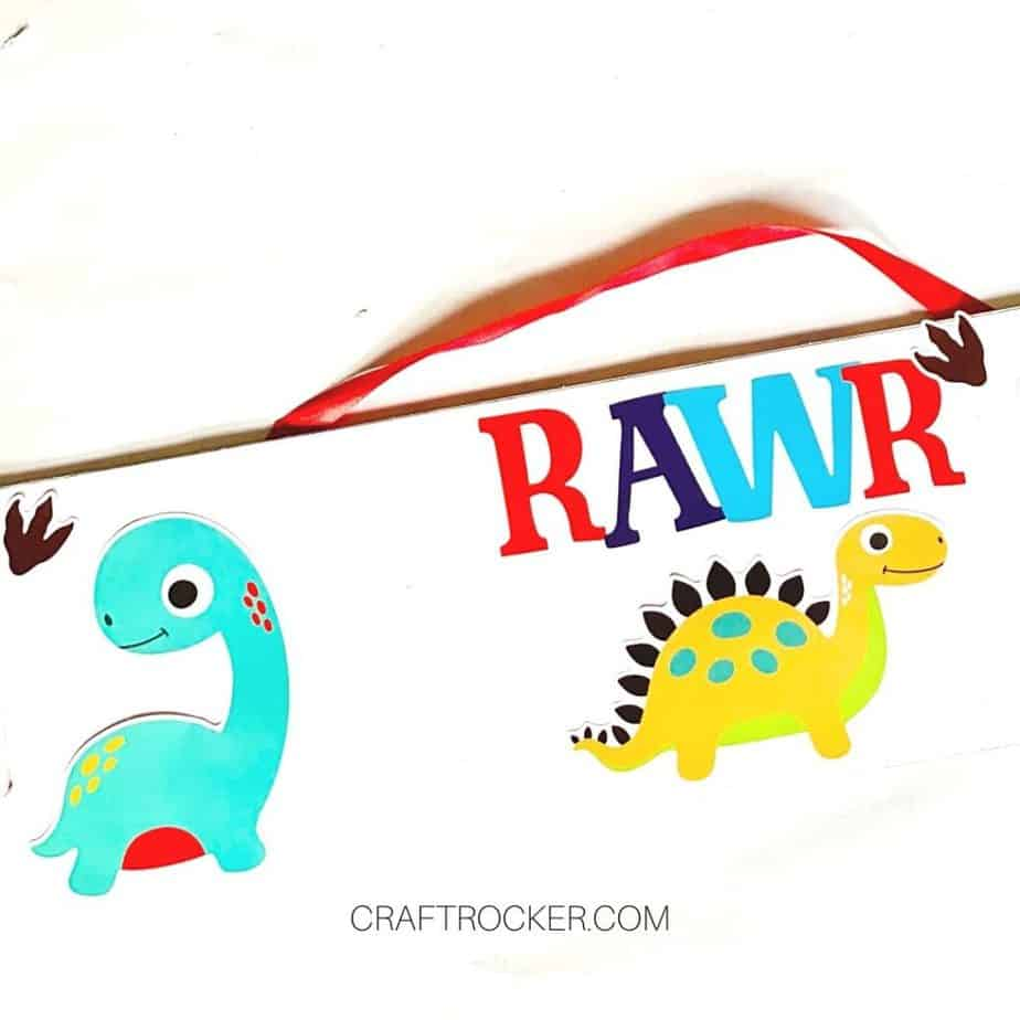 Close Up of Dinosaur Stickers Attached to Wood Sign - Craft Rocker