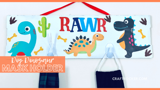 Close Up of Hanging Mask Holder with text overlay - DIY Dinosaur Mask Holder - Craft Rocker