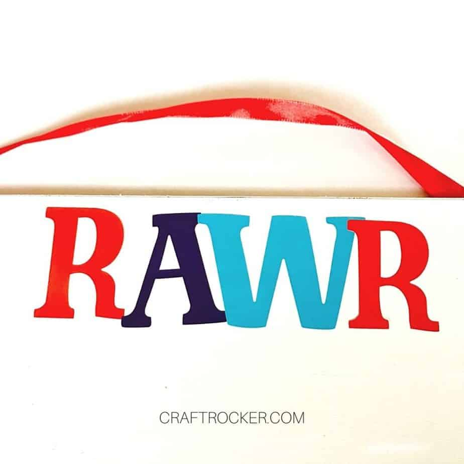 Close Up of Letter Stickers RAWR Attached to Center of Wood Sign - Craft Rocker