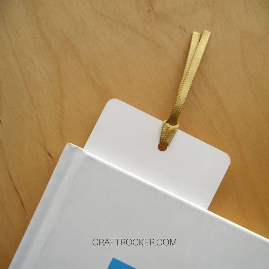 Close Up of Paper Bookmark Sticking Out of Top of Book - Craft Rocker