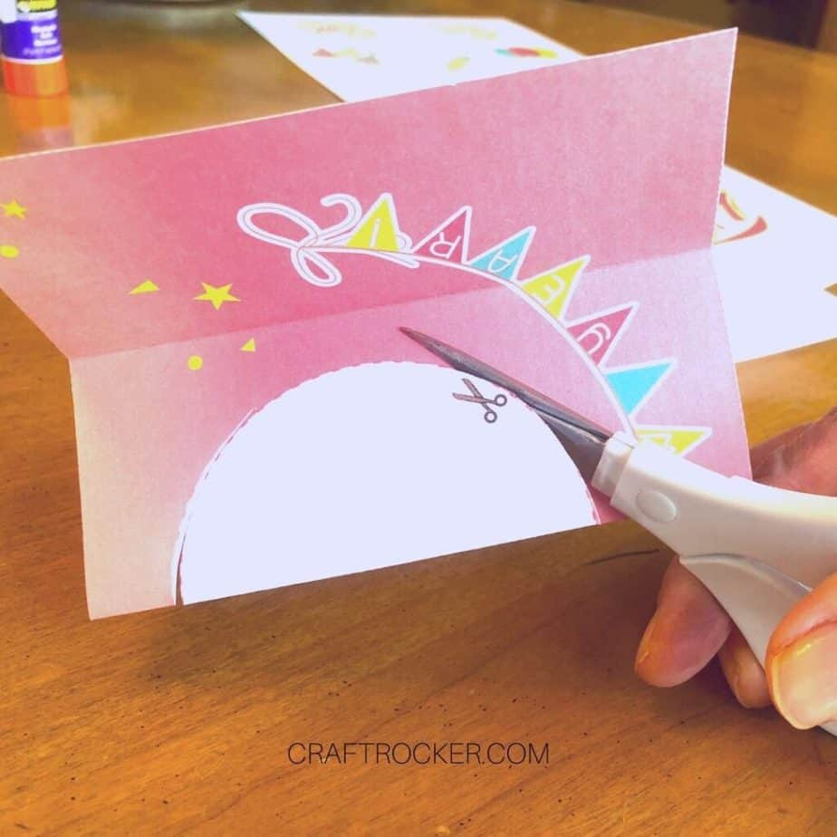 Close Up of Scissors Cutting Circle Out of New Year's Card Insert - Craft Rocker
