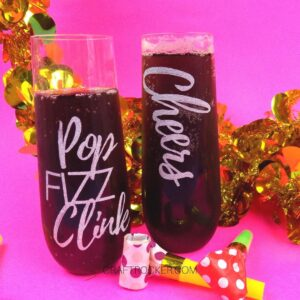 Filled DIY New Year's Champagne Flutes next to Decorations - Craft Rocker