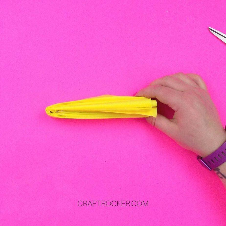 Hand Holding Folded Yellow Tissue Paper - Craft Rocker