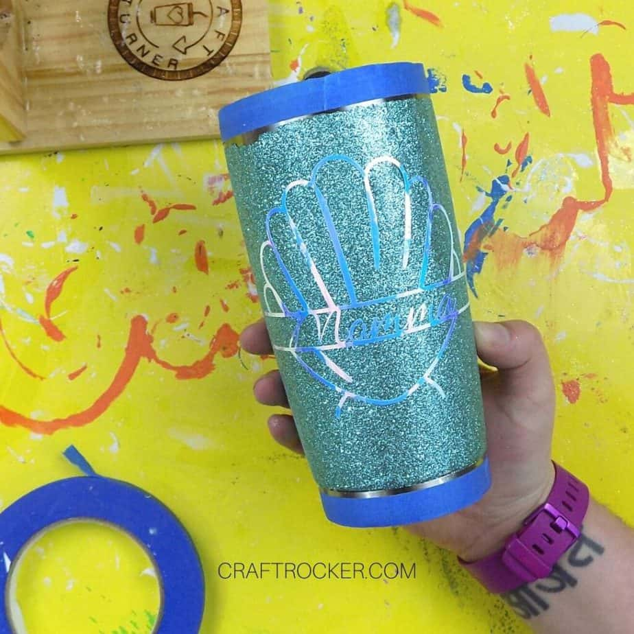 Hand Holding Taped Glitter Tumbler with Vinyl Design on It - Craft Rocker