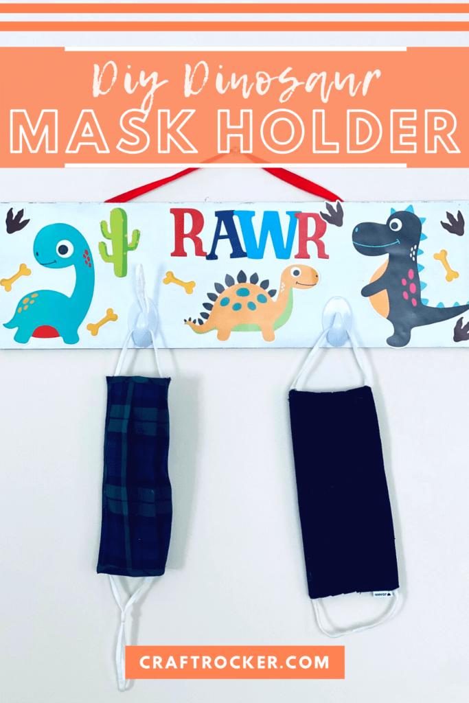 Hanging Mask Holder with Masks on it with text overlay - DIY Dinosaur Mask Holder - Craft Rocker