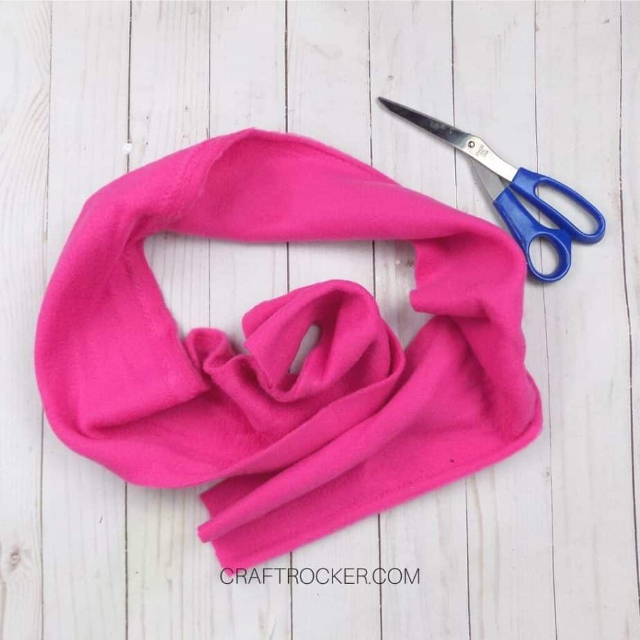 Piece of Hot Pink Fleece next to Scissors - Craft Rocker