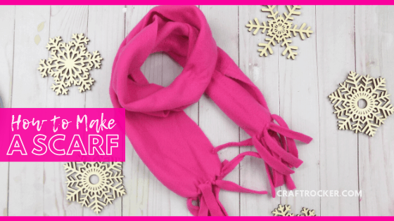 Pink Fleece Scarf next to Wood Snowflakes with text overlay - How to Make a Scarf - Craft Rocker