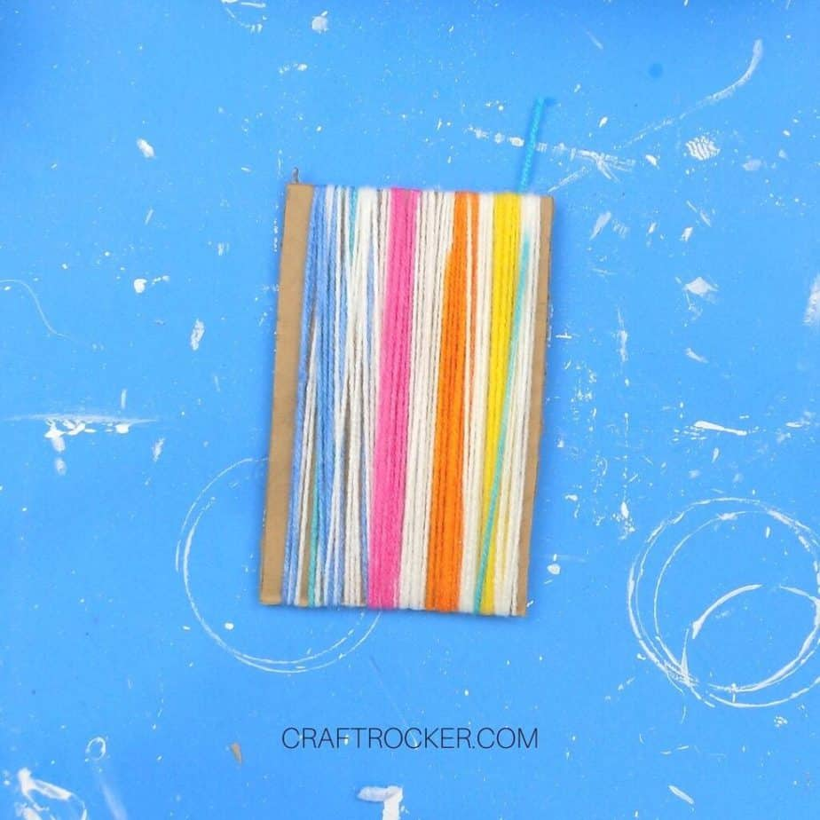 Rainbow Yarn Wrapped Around Cardboard Rectangle - Craft Rocker