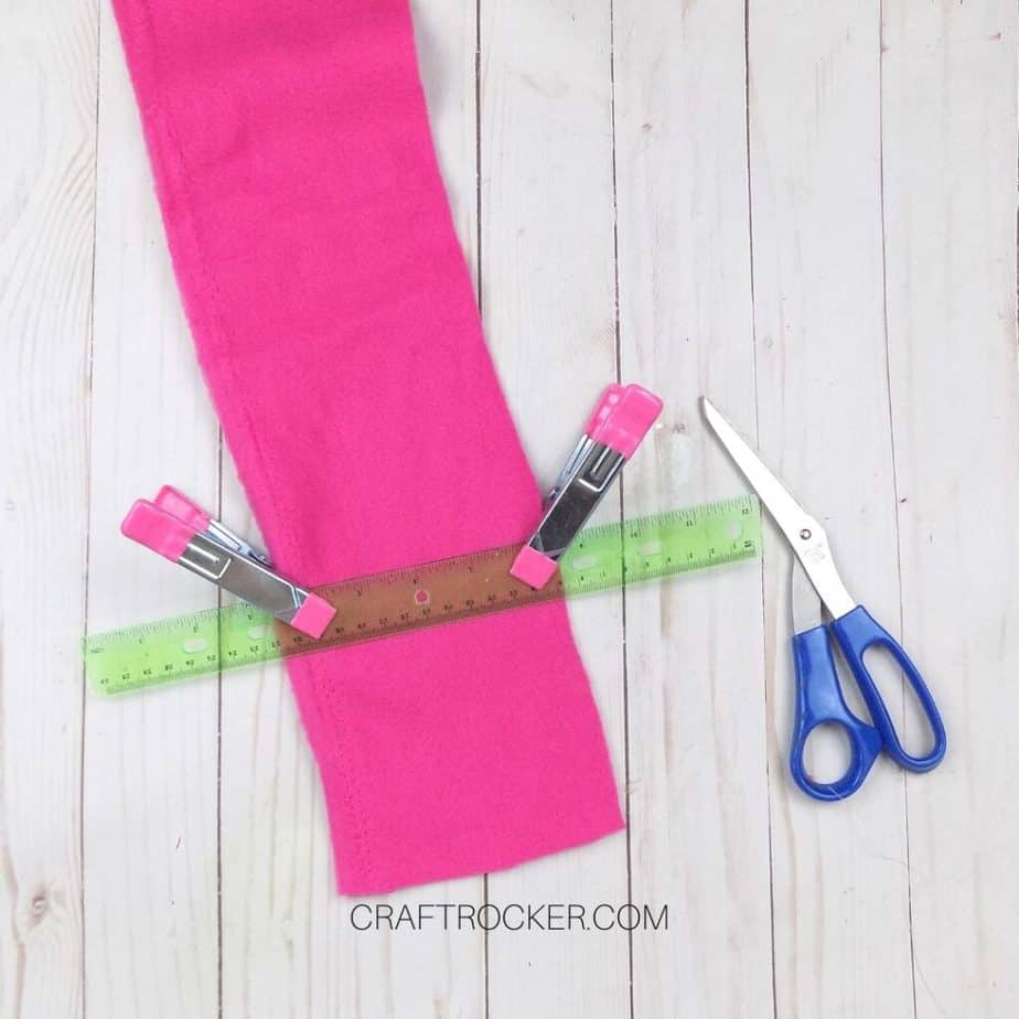 Ruler Clipped to Piece of Hot Pink Fleece next to Scissors - Craft Rocker