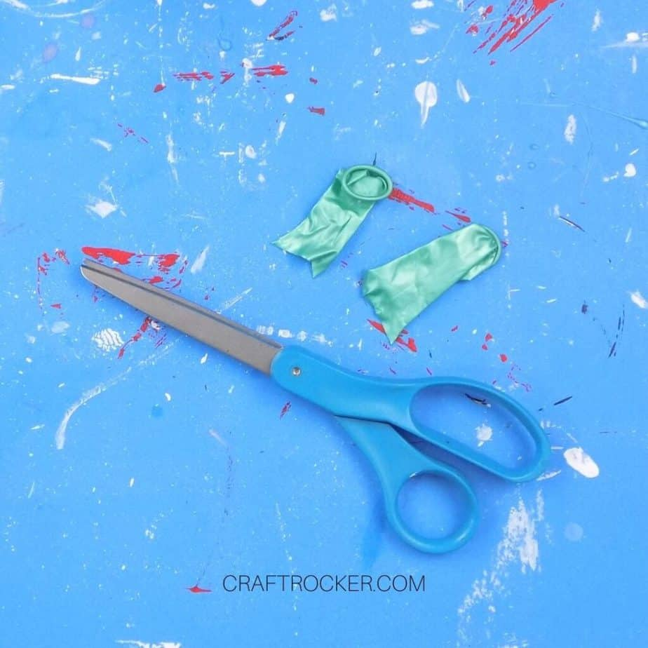 Scissors Next to Cut Pieces of Balloons - Craft Rocker