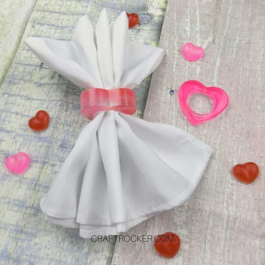 Angled View of White Napkin in a Heart Napkin Ring next to Pink Heart Napkin Ring - Craft Rocker