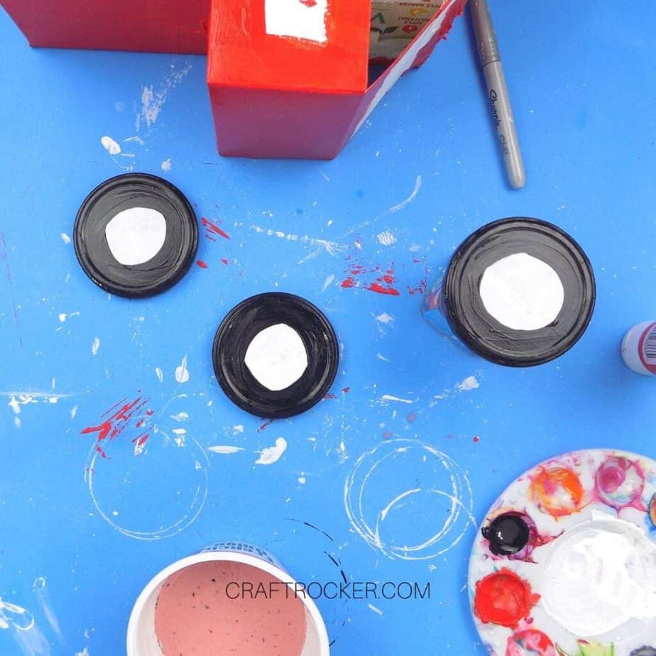 Black Paint on Outer Edge of White Salsa Lids - Craft Rocker