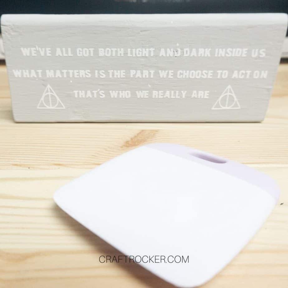Close Up Harry Potter Vinyl Quote on Wood Block next to Scraper Tool - Craft Rocker