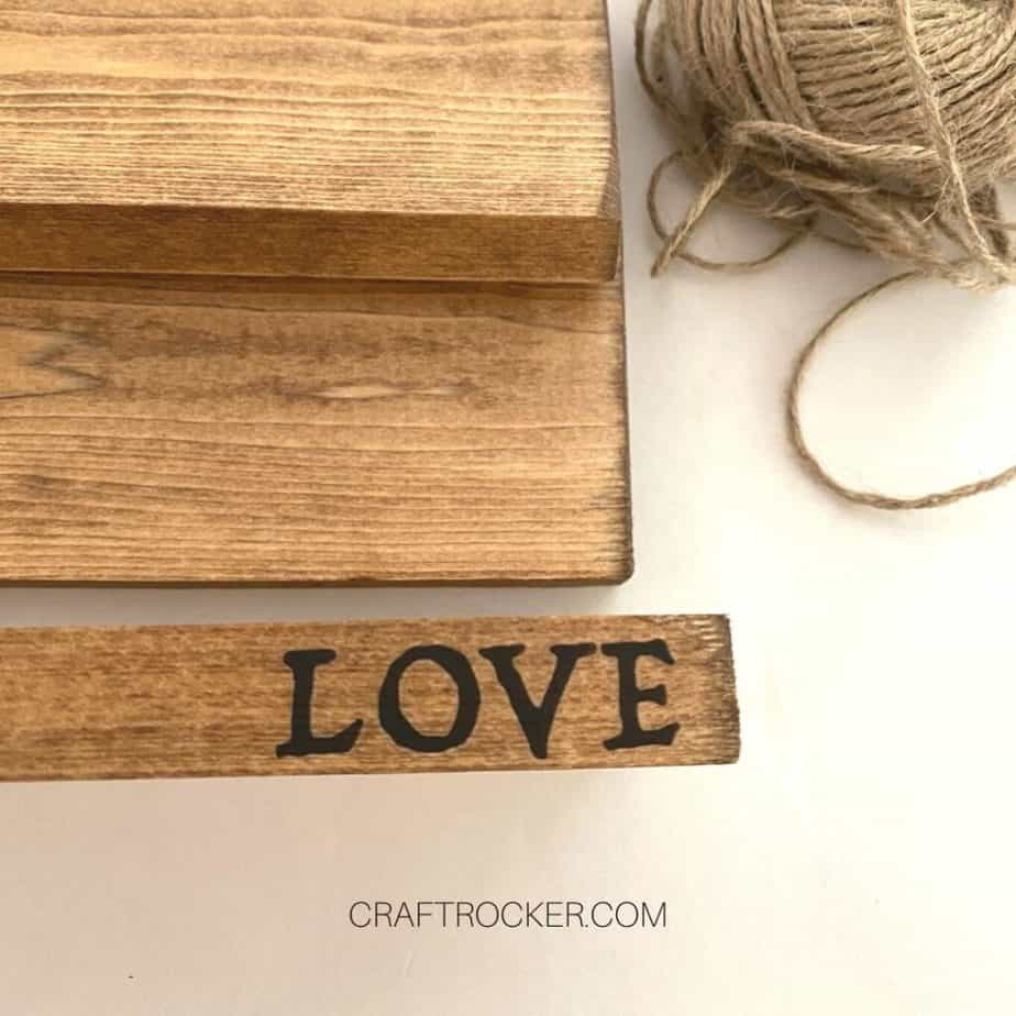 Close Up of Black Word Love on Stained Wood Block - Craft Rocker