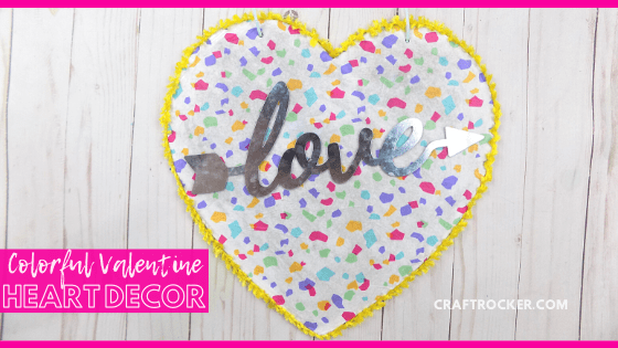 Close Up of Confetti Heart Wall Hanging with text overlay - Colorful Valentine Heart Decor - Craft Rocker