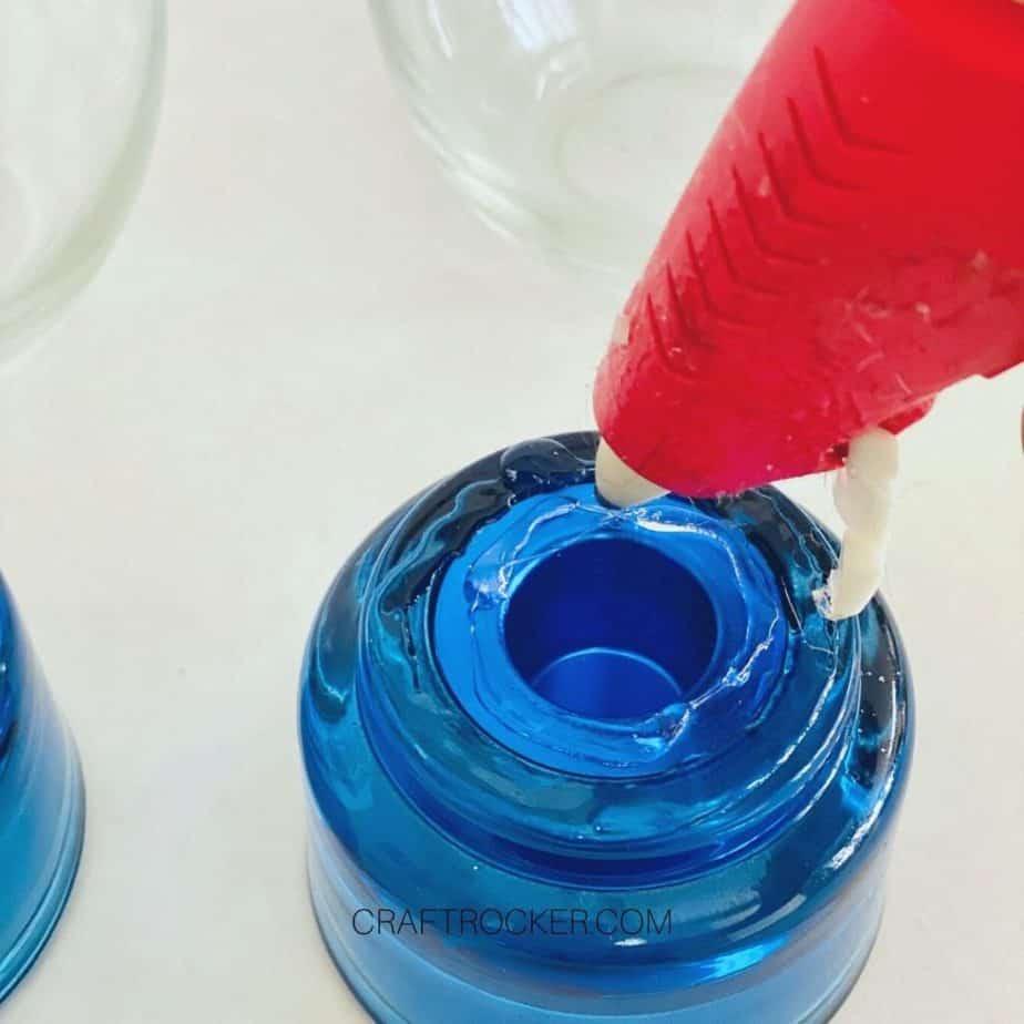Close Up of Glue Gun Adding Hot Glue to Center of the bottom of Candle Holder - Craft Rocker