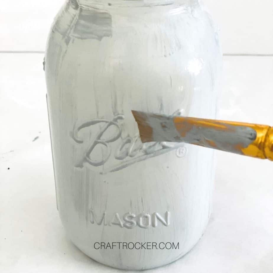 Close Up of Paintbrush Putting Gray Chalk Paint on Mason Jar - Craft Rocker