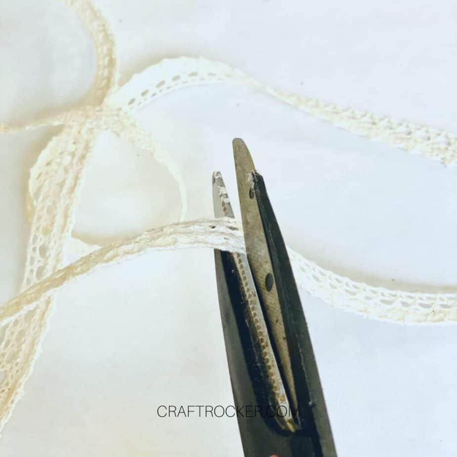 Close Up of Scissors Cutting Lace Ribbon - Craft Rocker