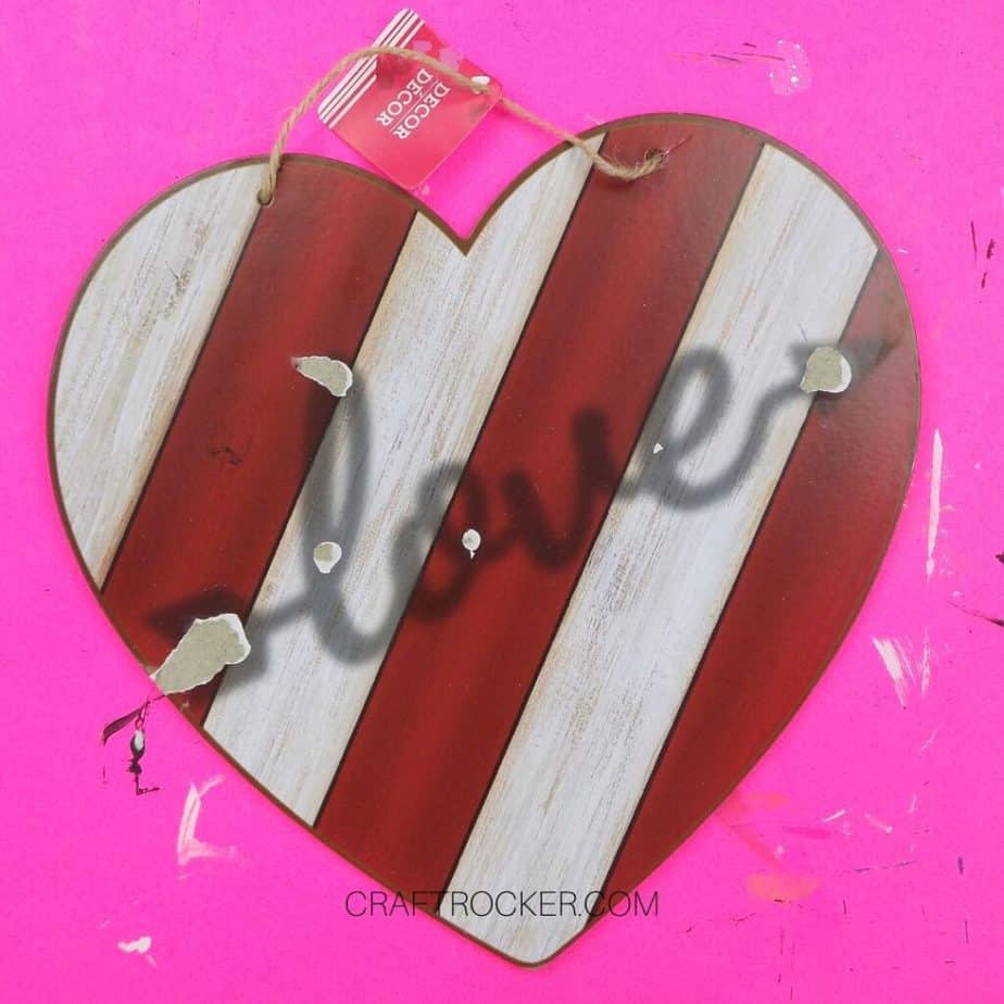 Close Up of Striped Wood Heart Sign with Metal Word Removed from Center - Craft Rocker