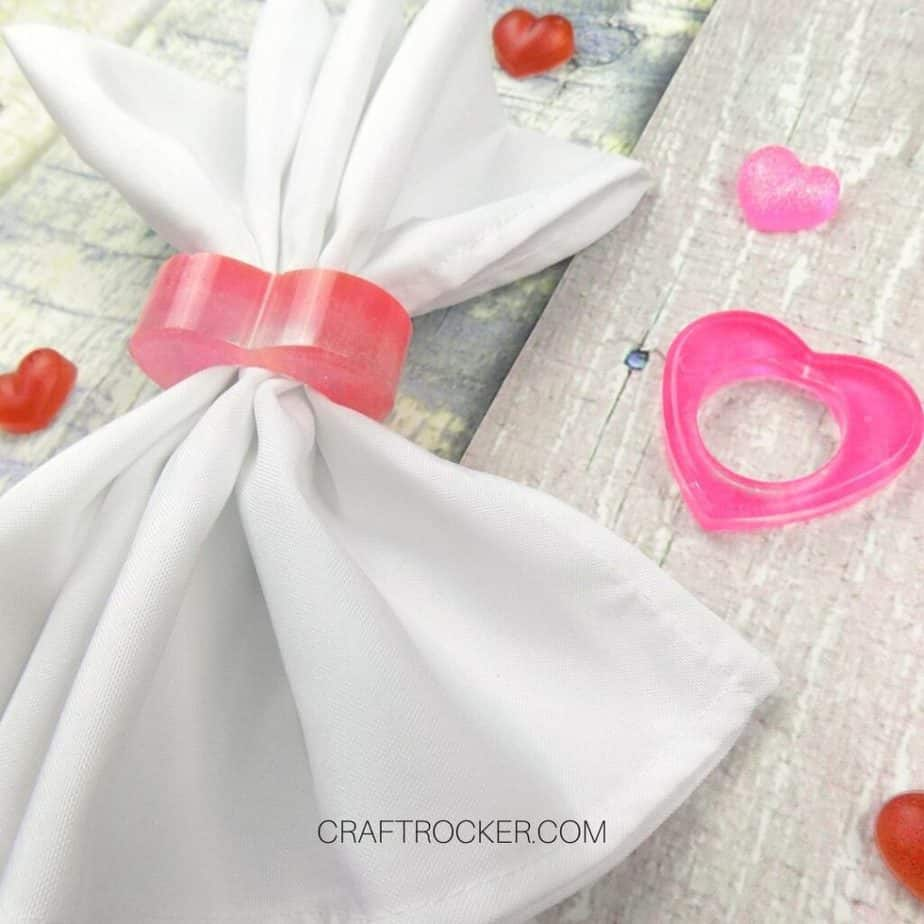 Close Up of White Napkin in a Heart Napkin Ring next to Pink Heart Napkin Ring - Craft Rocker