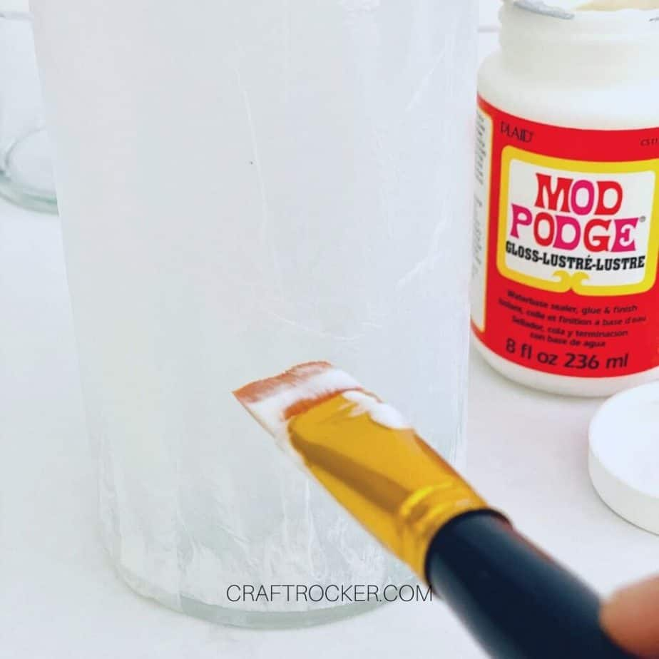 Close Up of White Tissue Paper on Vase next to Container of Mod Podge - Craft Rocker