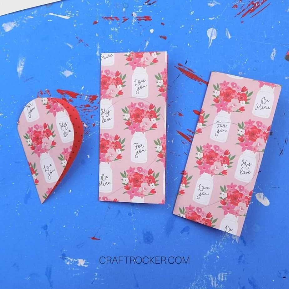 Cut Paper Heart next to 2 Folded Pieces of Paper - Craft Rocker