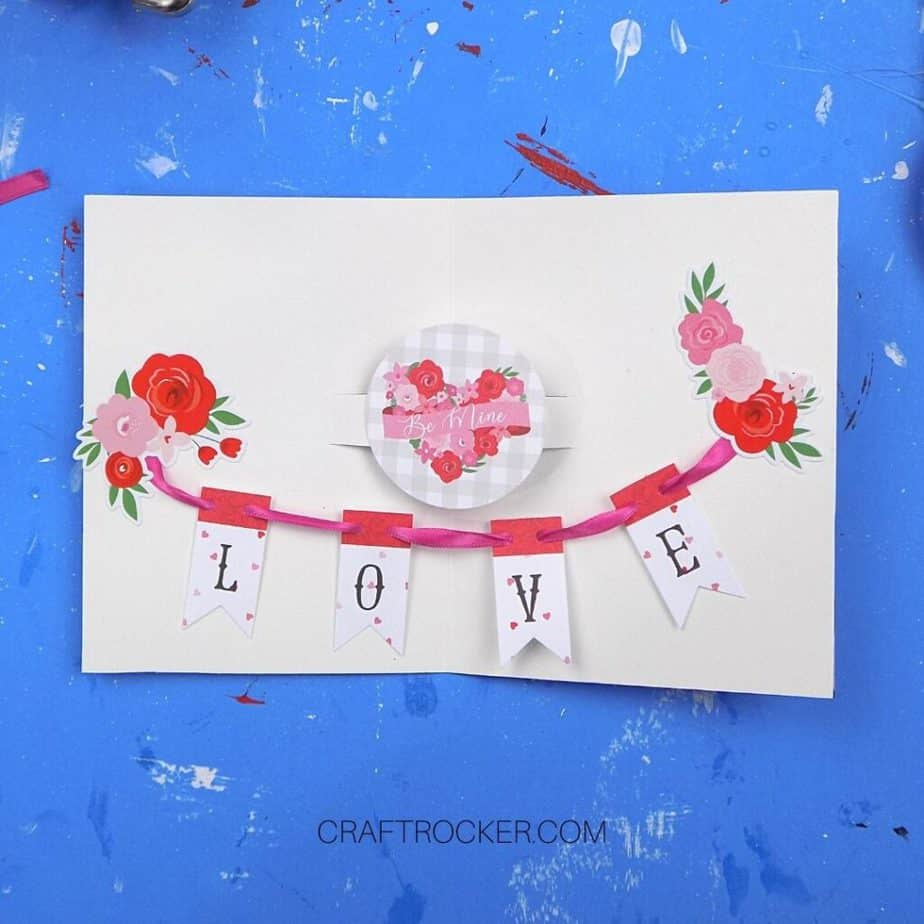 Flower Stickers on Edges of L-O-V-E Banner Attached to Inside of Pop Up Heart Card - Craft Rocker