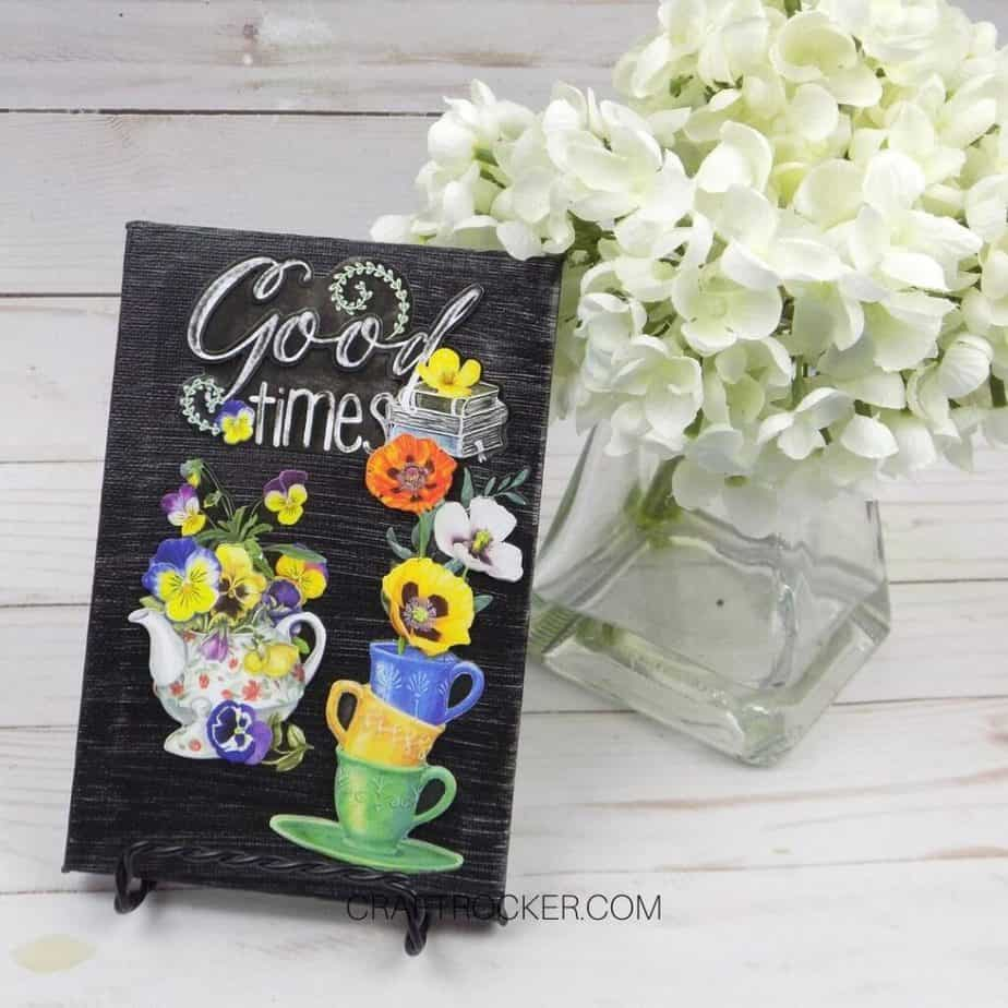 Good Times Decorative Canvas next to Vase of Flowers - Craft Rocker