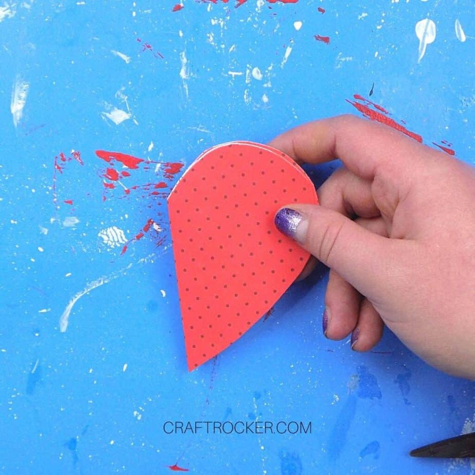 Hand Holding Glued Together Folded Paper Hearts - Craft Rocker