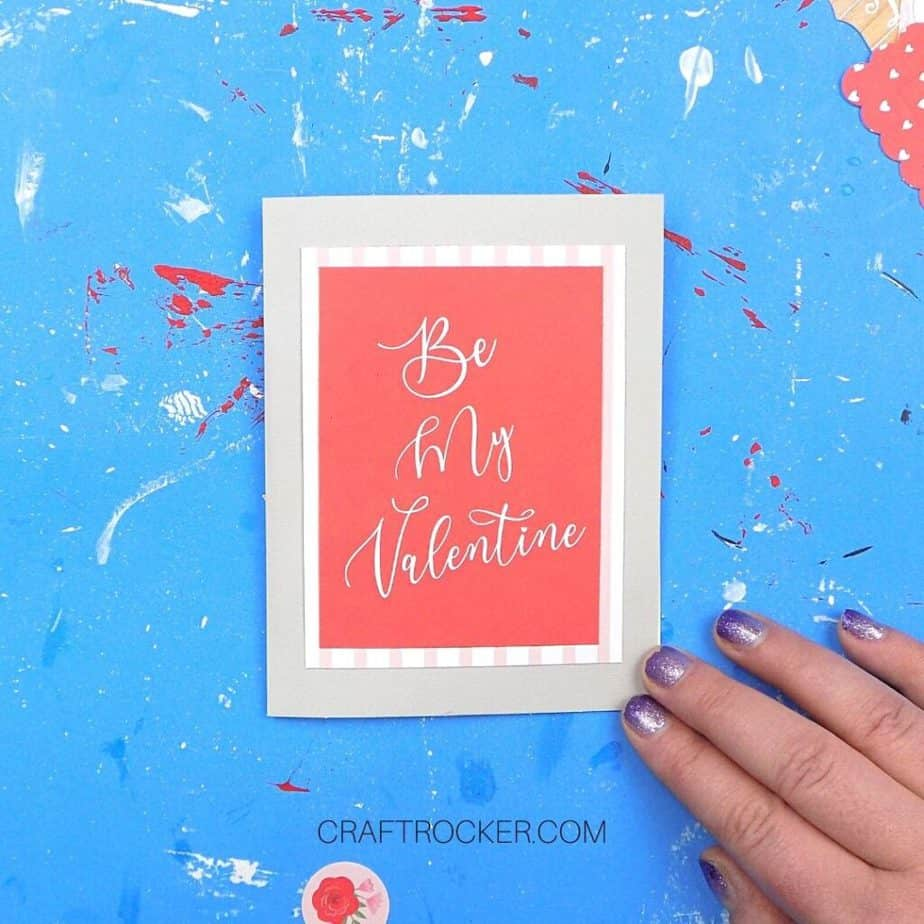 Hand Holding Greeting Card with Matted Be My Valentine Attached to Front - Craft Rocker