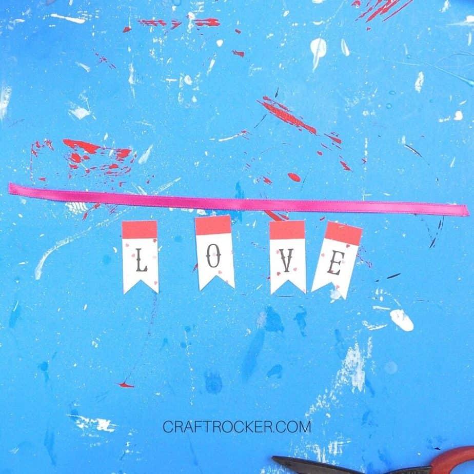 L-O-V-E Banner Elements next to Pink Ribbon - Craft Rocker