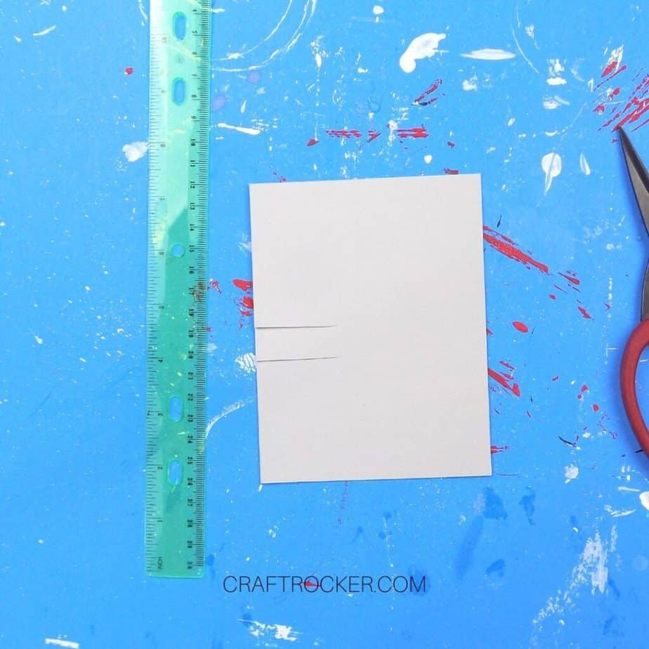 Slits Cut in Gray Greeting Card next to Ruler - Craft Rocker