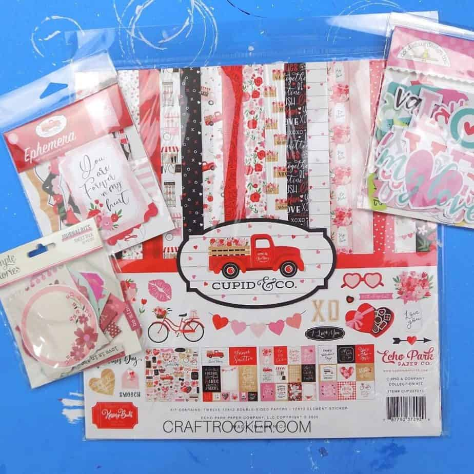 Valentine Paper Pack next to Embellishment Packs - Craft Rocker