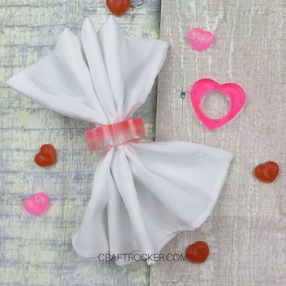 White Napkin in a Heart Napkin Ring next to Pink Heart Napkin Ring - Craft Rocker