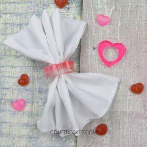 White Napkin in a Heart Napkin Ring next to Pink Heart Napkin Ring - Craft Rocker
