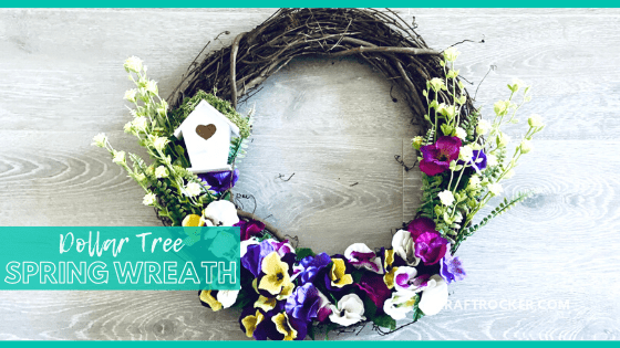 Birdhouse Floral Wreath on Wood Background with text overlay - Dollar Tree Spring Wreath - Craft Rocker
