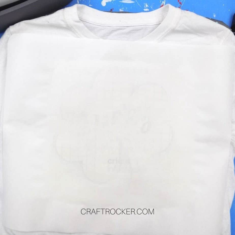 Butcher Paper Covering Lucky Shamrock Transfer on White T-shirt - Craft Rocker